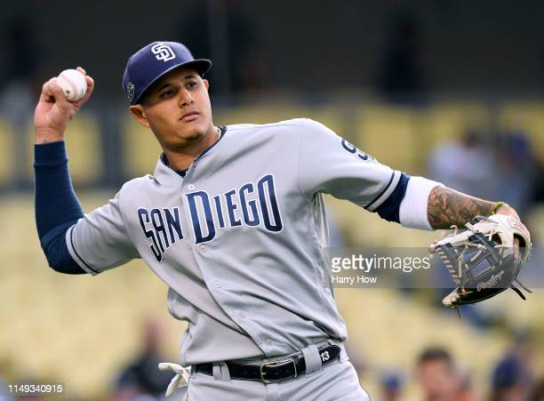 Manny Machado of the San Diego Padres warms up before the game against the Los Angeles Dodgers at Dodger Stadium on May 14 2019 in Los Angeles...