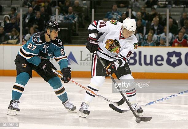 Manny Malhota of the San Jose Sharks and Marian Hossa of the Chicago Blackhawks go for the puck during their game at HP Pavilion on November 25 2009...