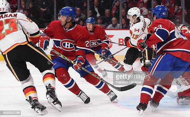 Manny Malhotra and Travis Moen of the Montreal Canadiens skates for position against the Calgary Flames in the NHL game at the Bell Centre on...