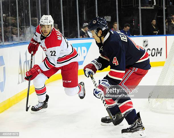 Manny Malhotra of the Carolina Hurricanes skates against Michael Del Zotto of the New York Rangers during the first period at Madison Square Garden...