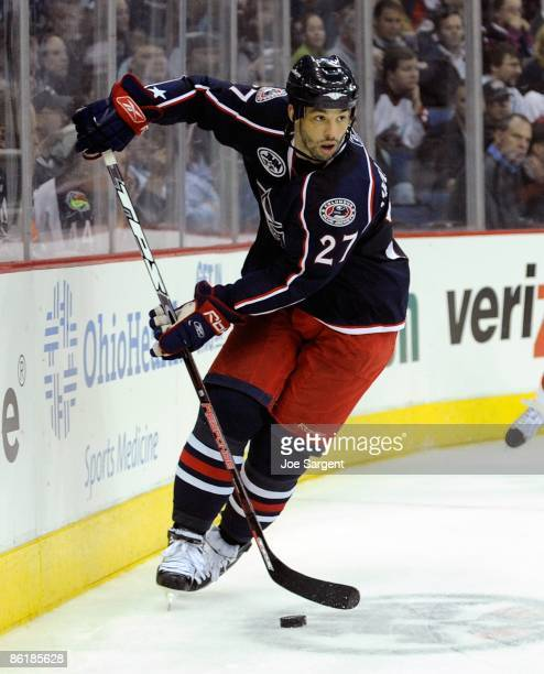 Manny Malhotra of the Columbus Blue Jackets controls the puck against the Detroit Red Wings during Game Three of the Western Conference Quarterfinals...