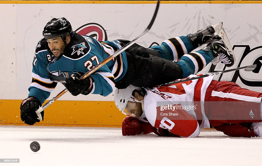 Manny Malhotra #27 of the San Jose Sharks dives over Henrik Zetterberg #40 of the Detroit Red Wings in Game Two of the Western Conference Semifinals during the 2010 NHL Stanley Cup Playoffs at HP Pavilion on May 2, 2010 in San Jose, California.