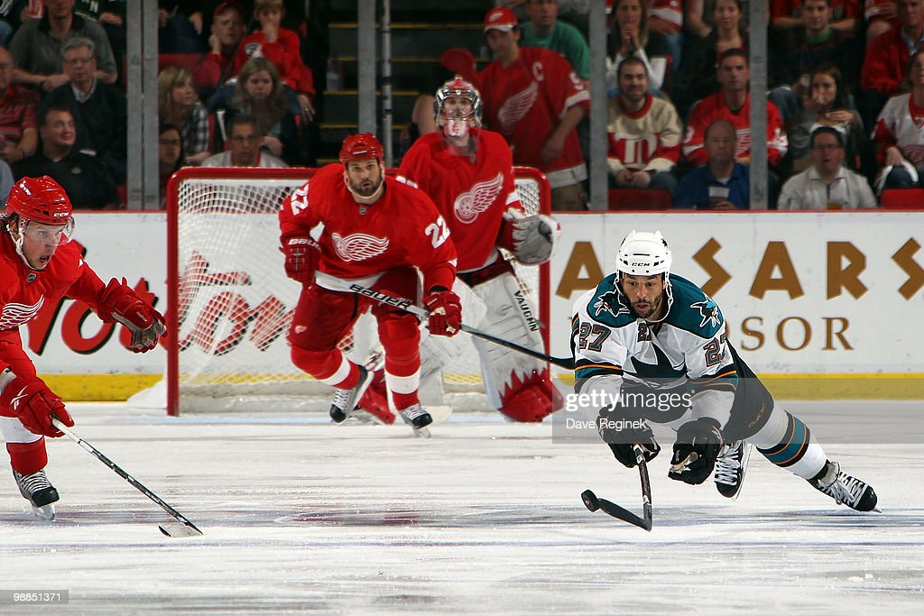 Manny Malhotra #27 of the San Jose Sharks dives to get the puck before Justin Abdelkader #8 of the Detroit Red Wings during Game Three of the Western Conference Semifinals of the 2010 NHL Stanley Cup Playoffs at Joe Louis Arena on May 4, 2010 in Detroit, Michigan.