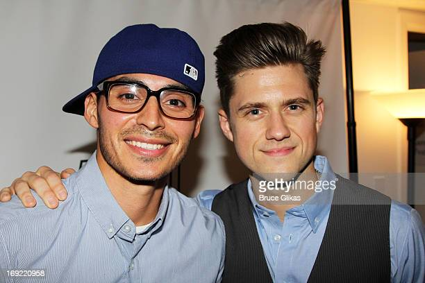 Manny Montana and Aaron Tveit pose backstage at 54 Below Nightclub on May 21 2013 in New York City