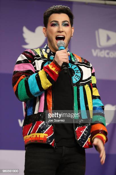 Manny MUA speaks onstage during the 'Escape the Night 3 Welcome to Everlock' panel during the 9'th Annual VidCon at Anaheim Convention Center on June...
