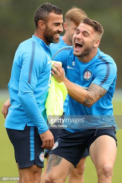 Manny Muscat and Bart Schenkeveld of Melbourne City share a joke during a break at a Melbourne City FC ALeague training session at City Football...