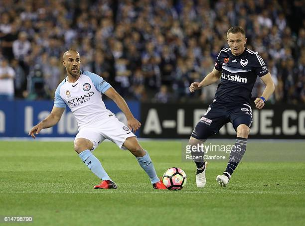 Manny Muscat of Melbourne City gets the ball away from Besart Berisha of the Victory during the round two ALeague match between Melbourne Victory and...