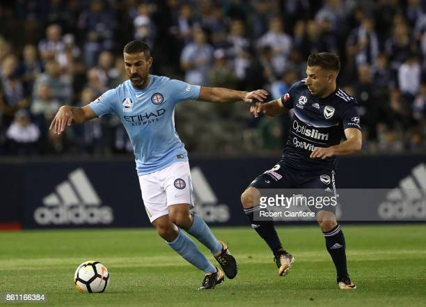 Manny Muscat of Melbourne City is challenged by Kosta Barbarouses of the Victory during the round two ALeague match between Melbourne Victory and...