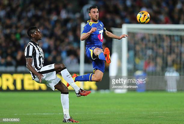 Manny Muscat of the All Stars competes with Paul Pogba of Juventus during the match between the ALeague All Stars and Juventus at ANZ Stadium on...