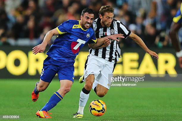 Manny Muscat of the All Stars is challenged by Claudio Marchisio of Juventus during the match between the ALeague All Stars and Juventus at ANZ...