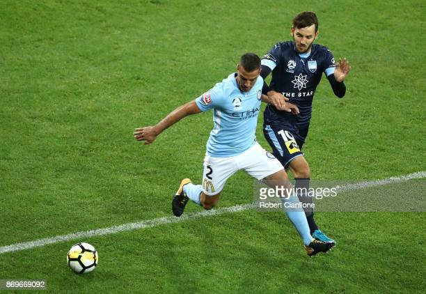 Manny Muscat of the City is chased by Milos Ninkovic of Sydney FC during the round five ALeague match between Melbourne City FC and Sydney FC at AAMI...