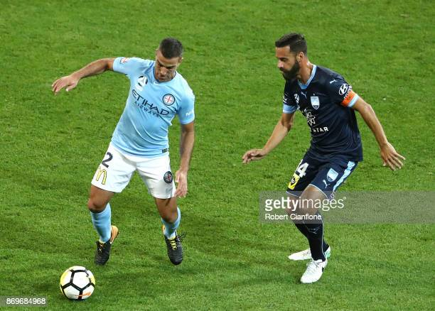 Manny Muscat of the Cityis pressured by Alex Brosque of Sydney FC during the round five ALeague match between Melbourne City FC and Sydney FC at AAMI...