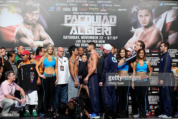 Manny Pacquiao and Chris Algieri face off during the official weigh in at The Venetianon on November 22 2014 in Macau Macau