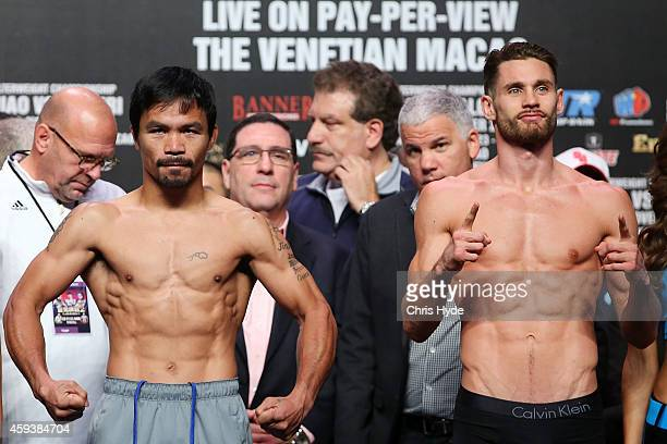 Manny Pacquiao and Chris Algieri pose during the official weigh in at The Venetianon on November 22 2014 in Macau Macau