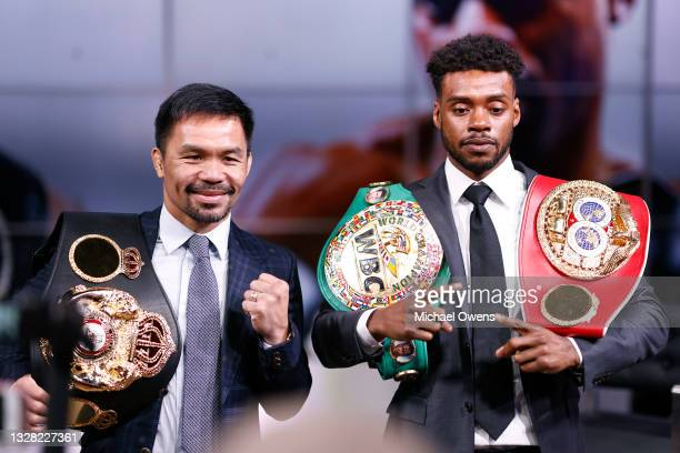 Manny Pacquiao and Errol Spence Jr pose for the media following their press conference at Fox Studios on July 11, 2021 in Los Angeles, California....