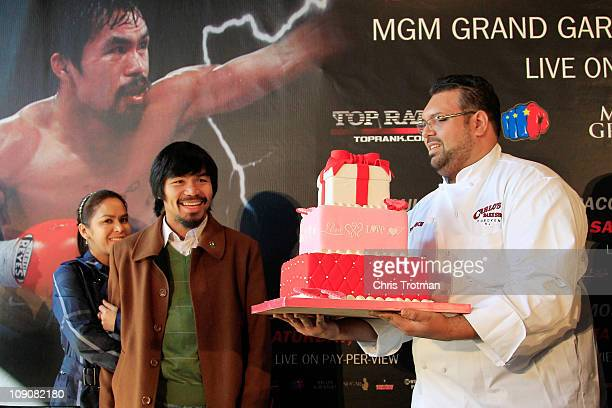 Manny Pacquiao and his wife Jinkee Pacquiao are presented with a Valentines Day cake at a press conference to promote his fight with Shane Mosley at...