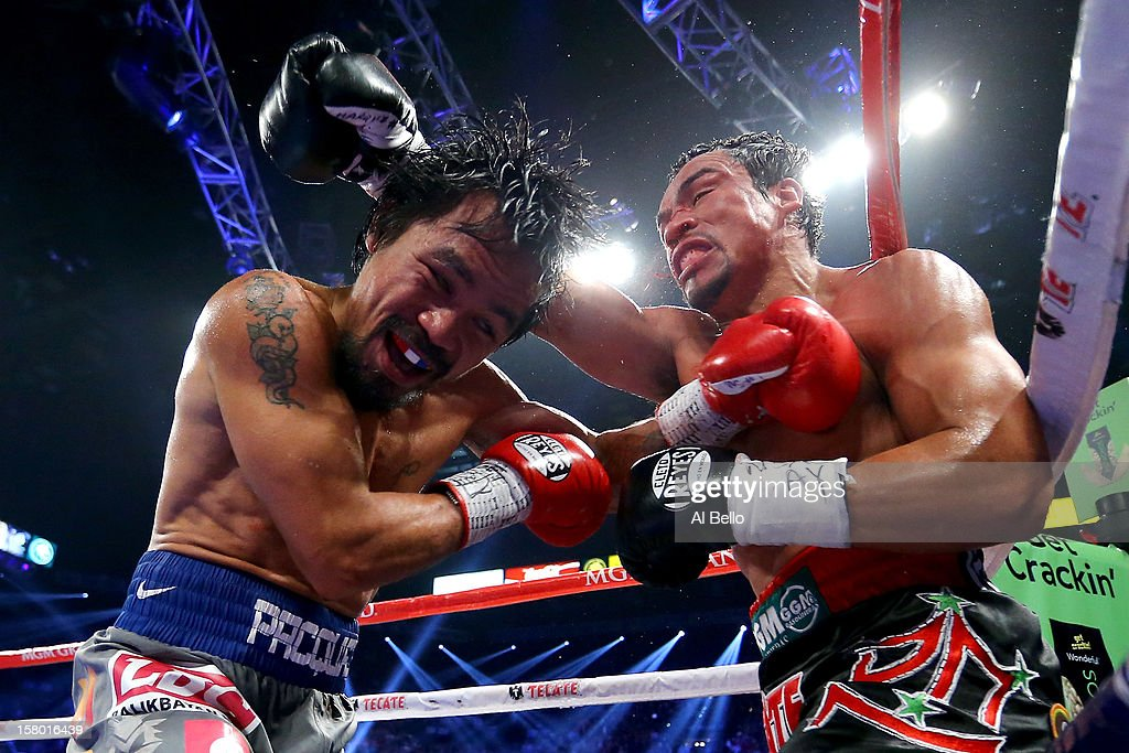 Manny Pacquiao and Juan Manuel Marquez exchange blows during their welterweight bout at the MGM Grand Garden Arena on December 8, 2012 in Las Vegas, Nevada.
