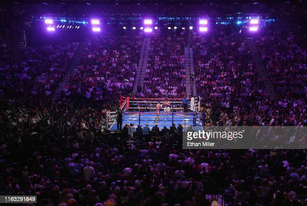 Manny Pacquiao and Keith Thurman battle in the third round of their WBA welterweight title fight at MGM Grand Garden Arena on July 20, 2019 in Las...