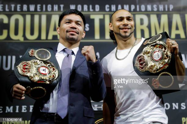 Manny Pacquiao and Keith Thurman pose for the media during a press conference at Gotham Hall in preparation for their upcoming fight on May 21 2019...