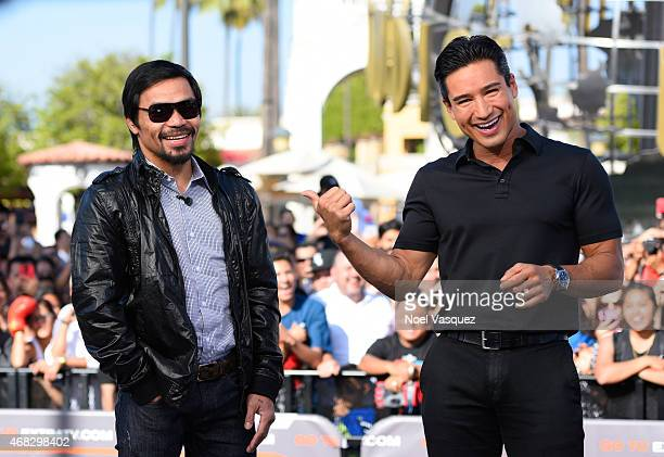 Manny Pacquiao and Mario Lopez visit 'Extra' at Universal Studios Hollywood on April 1 2015 in Universal City California