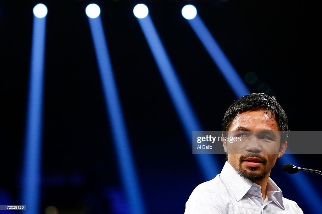 Manny Pacquiao answers questions during the post-fight news conference after losing to Floyd Mayweather Jr. in their welterweight unification championship bout on May 2, 2015 at MGM Grand Garden Arena in Las Vegas, Nevada.