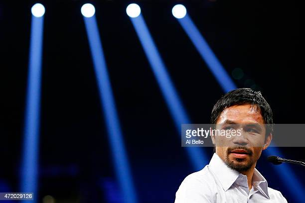 Manny Pacquiao answers questions during the postfight news conference after losing to Floyd Mayweather Jr in their welterweight unification...