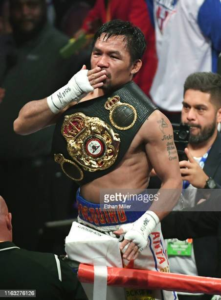 Manny Pacquiao blows a kiss to the crowd as he celebrates his splitdecision victory over Keith Thurman in their WBA welterweight title fight at MGM...
