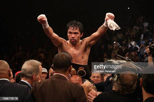 Manny Pacquiao celebrates after defeating Adrien Broner by unanimous decision during the WBA welterweight championship at MGM Grand Garden Arena on...