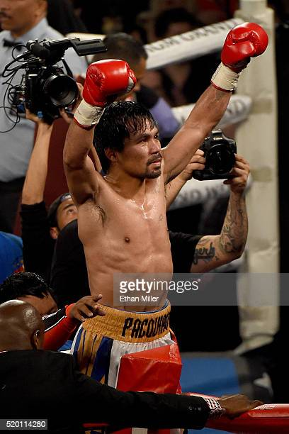 Manny Pacquiao celebrates after defeating Timothy Bradley Jr in their welterweight fight on April 9 2016 at MGM Grand Garden Arena in Las Vegas...