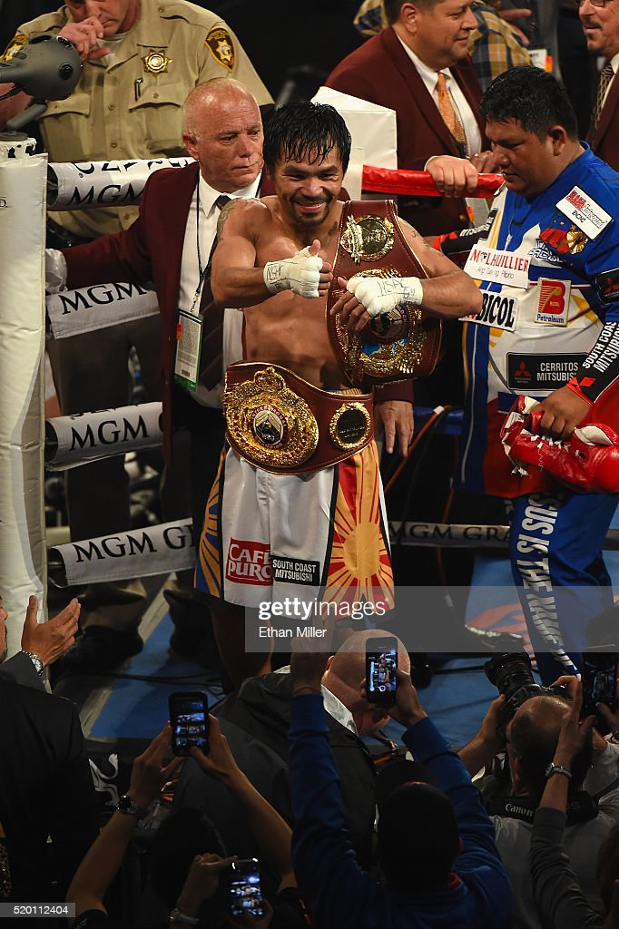 Manny Pacquiao celebrates as he leaves the ring after defeating Timothy Bradley Jr. by unanimous decision in their welterweight fight on April 9, 2016 at MGM Grand Garden Arena in Las Vegas, Nevada.