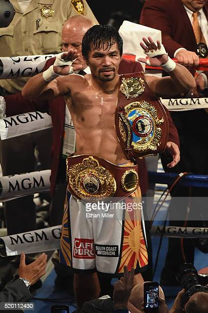 Manny Pacquiao celebrates as he leaves the ring after defeating Timothy Bradley Jr by unanimous decision in their welterweight fight on April 9 2016...