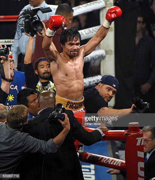Manny Pacquiao celebrates at the end of the 12th round of his welterweight fight against Timothy Bradley Jr on April 9 2016 at MGM Grand Garden Arena...