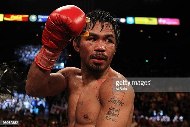 Manny Pacquiao celebrates his 12 round TKO victory against Miguel Cotto during their WBO welterweight title fight at the MGM Grand Garden Arena on...
