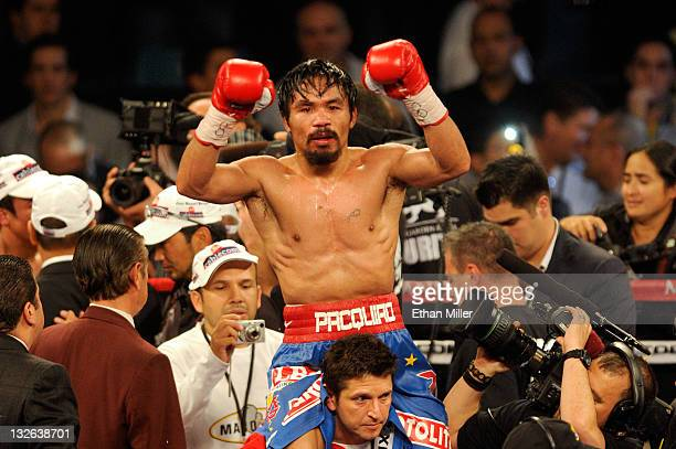 Manny Pacquiao celebrates his majority decision victory against Juan Manuel Marquez in the WBO world welterweight title fight at the MGM Grand Garden...