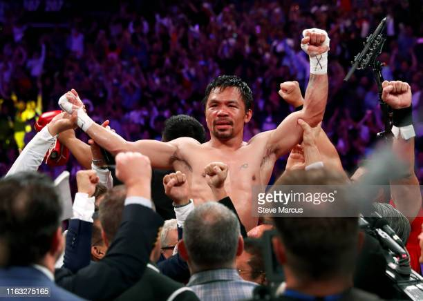 Manny Pacquiao celebrates his split decision victory over Keith Thurman in their WBA welterweight title fight at MGM Grand Garden Arena on July 20,...