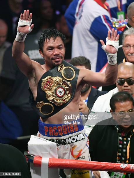 Manny Pacquiao celebrates his split-decision victory over Keith Thurman in their WBA welterweight title fight at MGM Grand Garden Arena on July 20,...