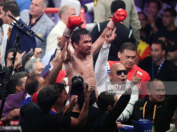 Manny Pacquiao celebrates his splitdecision victory over Keith Thurman in their WBA welterweight title fight at MGM Grand Garden Arena on July 20...