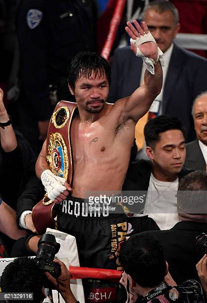 Manny Pacquiao celebrates his unanimousdecision victory over Jessie Vargas to win the WBO welterweight championship title at the Thomas Mack Center...