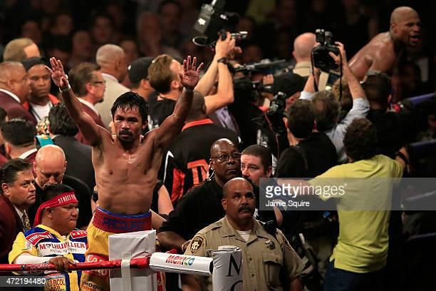 Manny Pacquiao gestures to the crowd after losing to Floyd Mayweather Jr in their welterweight unification championship bout on May 2 2015 at MGM...