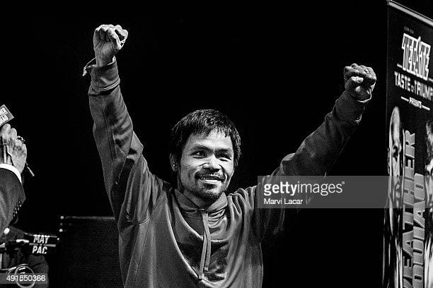 Manny Pacquiao gestures toward the crowd on May 1 at the MGM Grand Garden Arena in Las Vegas Nevada at the final weighin before his fight against...