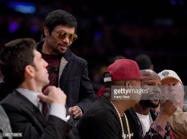 Manny Pacquiao greets Floyd Mayweather Jr as he passes by during the game between the Golden State Warriors and the Los Angeles Lakers at Staples...