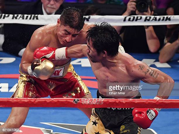 Manny Pacquiao hits Jessie Vargas iwith a right in the 12th round of their WBO welterweight championship fight at the Thomas Mack Center on November...