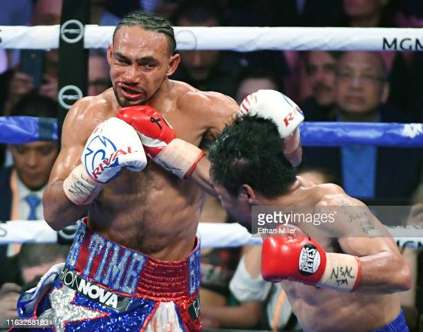 Manny Pacquiao hits Keith Thurman with a right in the eighth round of their WBA welterweight title fight at MGM Grand Garden Arena on July 20 2019 in...