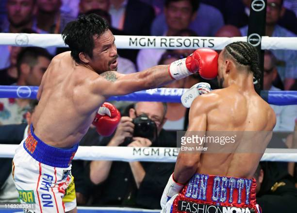Manny Pacquiao hits Keith Thurman with a right in the fourth round of their WBA welterweight title fight at MGM Grand Garden Arena on July 20 2019 in...