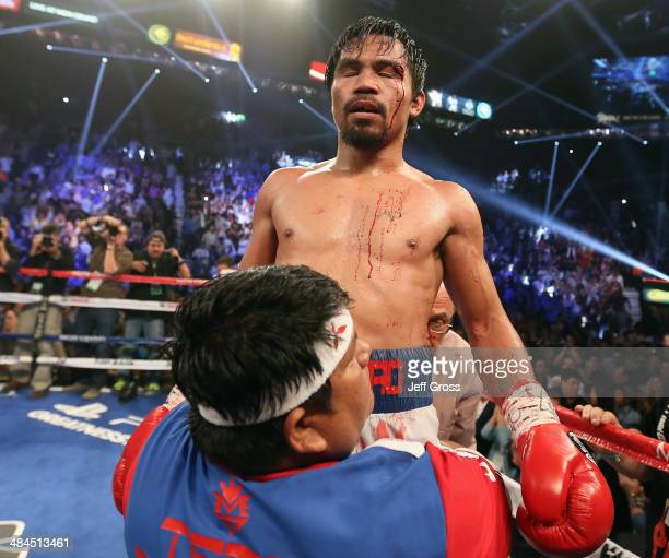 Manny Pacquiao is hoisted up by his corner following his match against Timothy Bradley at the MGM Grand Garden Arena on April 12 2014 in Las Vegas...
