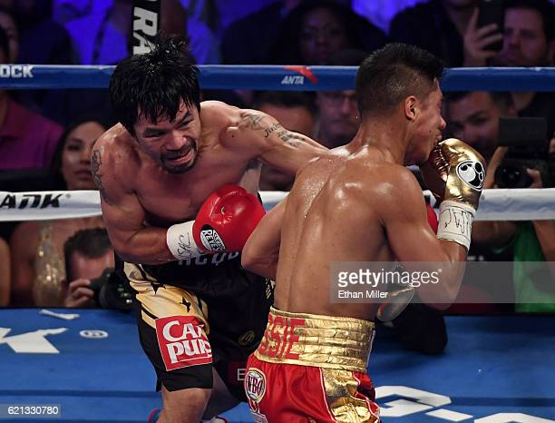 Manny Pacquiao knocks Jessie Vargas down with a left in the second round of their WBO welterweight championship fight at the Thomas Mack Center on...