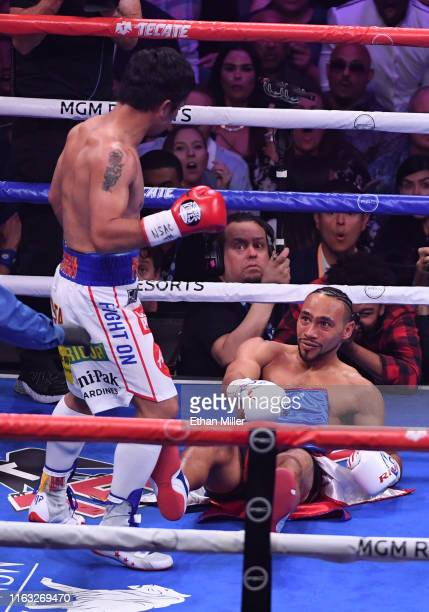 Manny Pacquiao knocks Keith Thurman down in the first round of their WBA welterweight title fight at MGM Grand Garden Arena on July 20 2019 in Las...