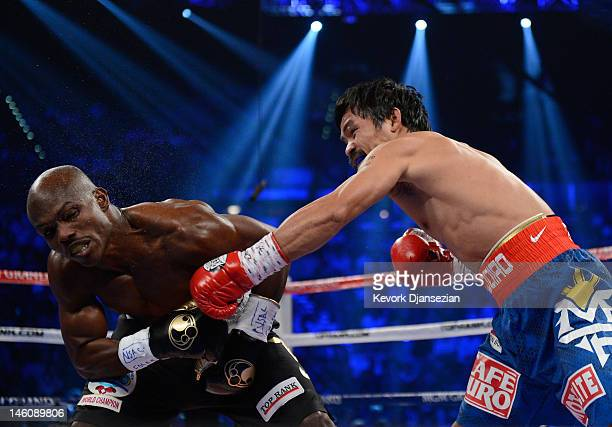Manny Pacquiao lands a left to the head of Timothy Bradley during their WBO welterweight title fight at MGM Grand Garden Arena on June 9 2012 in Las...