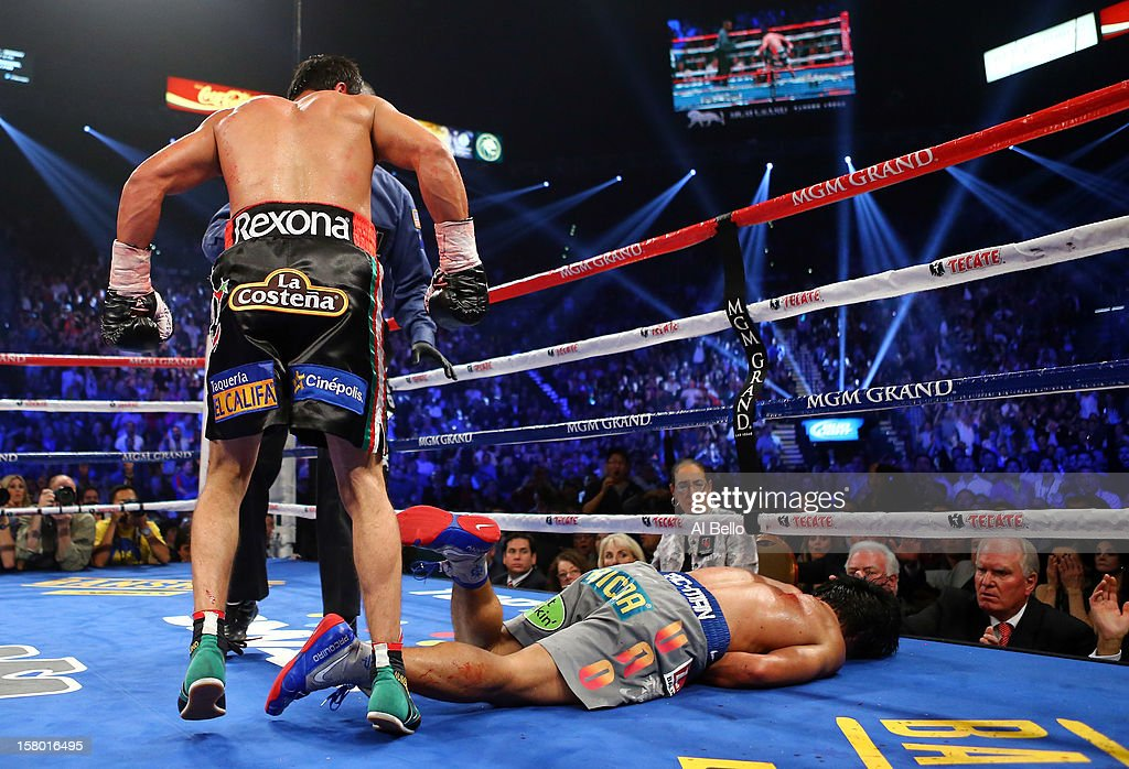 Manny Pacquiao lays face down on the mat after being knocked out in the sixth round by Juan Manuel Marquez during their welterweight bout at the MGM Grand Garden Arena on December 8, 2012 in Las Vegas, Nevada.