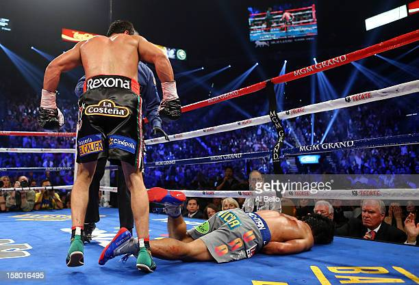 Manny Pacquiao lays face down on the mat after being knocked out in the sixth round by Juan Manuel Marquez during their welterweight bout at the MGM...